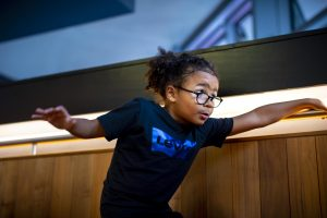 A young child performing on a staircase at The Marlowe.