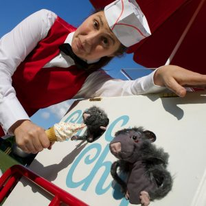 Photo of woman feeding an ice cream to puppet rats